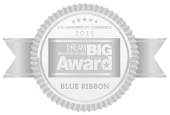 An illustration of a gray and white ribbon with the words Dream Big Award Blue Ribbon within it